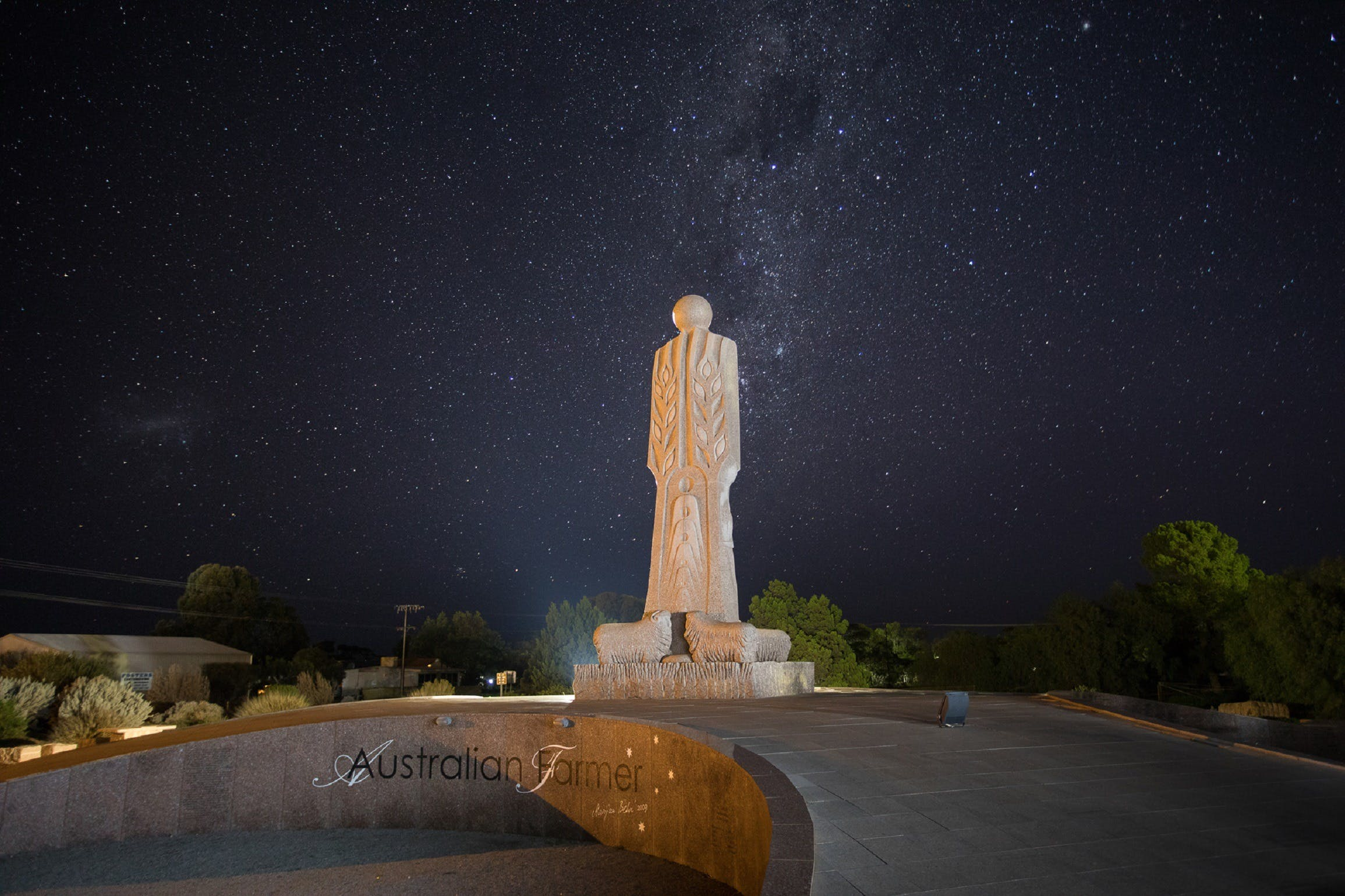The Australian Farmer Granite Sculpture - Tourism Cairns